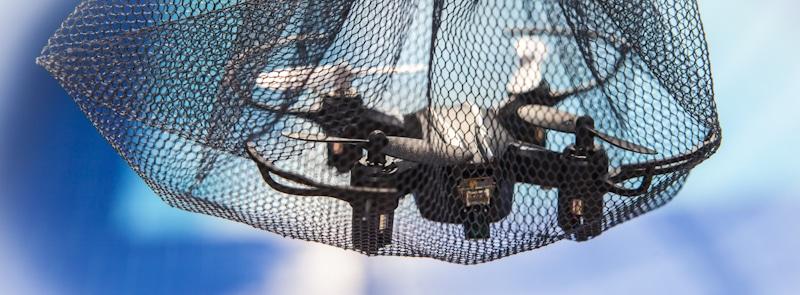 drone caught under net