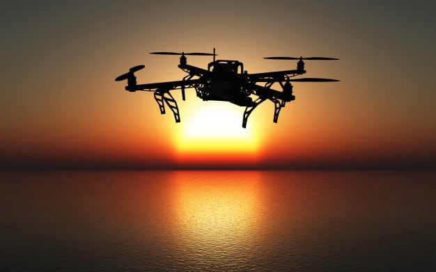 drone flying in sunset over the ocean