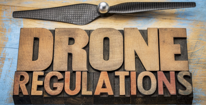 drone regulations sign in wood blocks