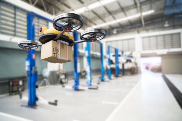 industrial drone flies to make a delivery