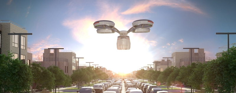 delivery drone flies over traffic