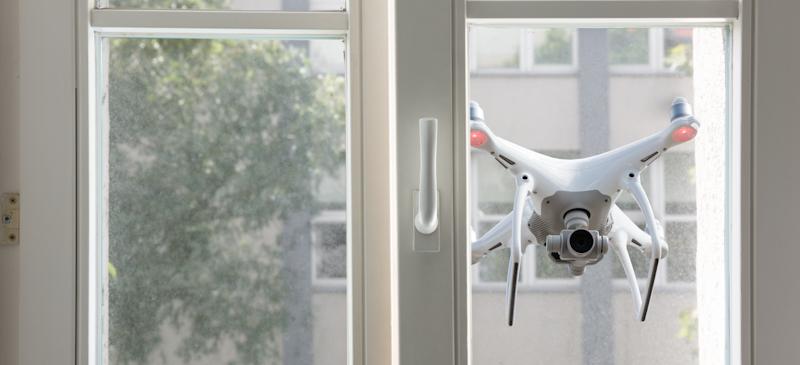 drone cam looks through house window