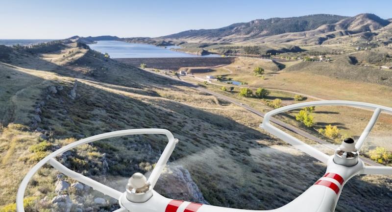 drone flies around dam