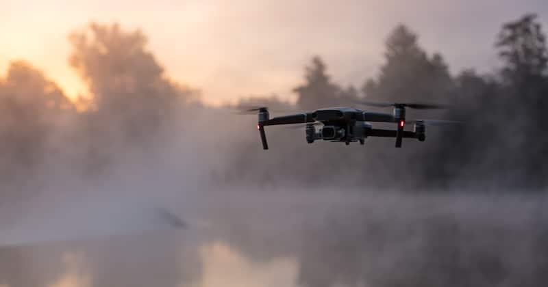 drone flies in foggy lake
