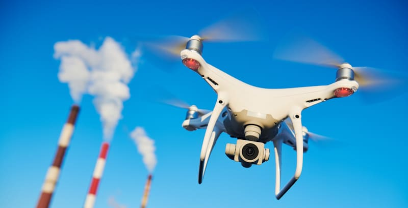 drone flies in front of power plant
