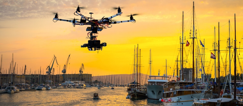 drone flies over the marina around boats