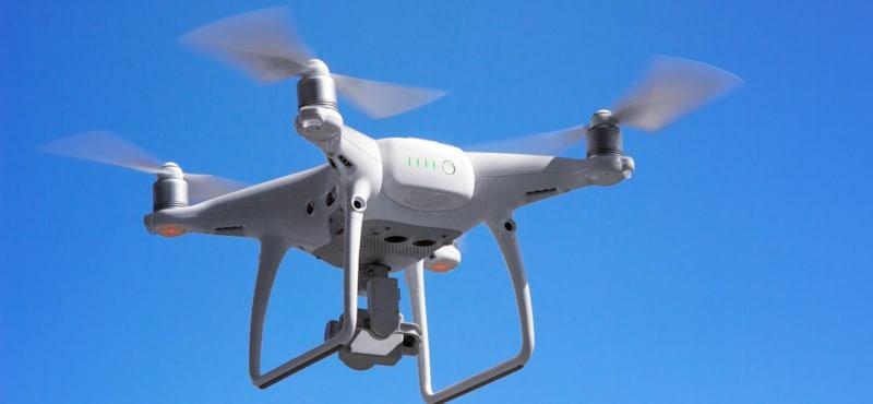 drone flying in blue sky