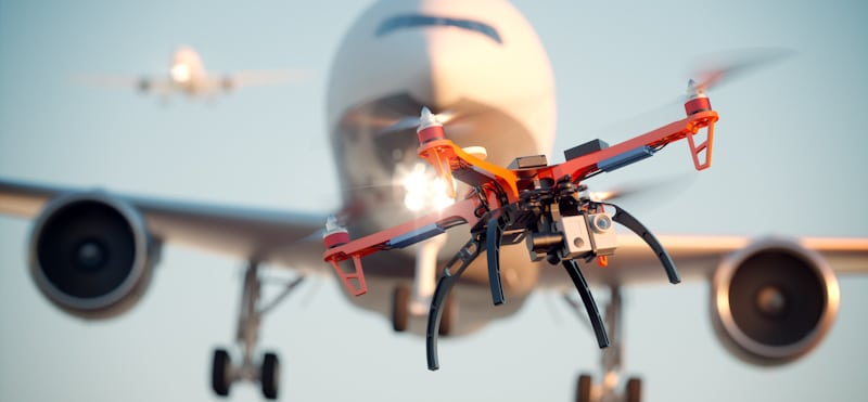 drone flying in front of a plane