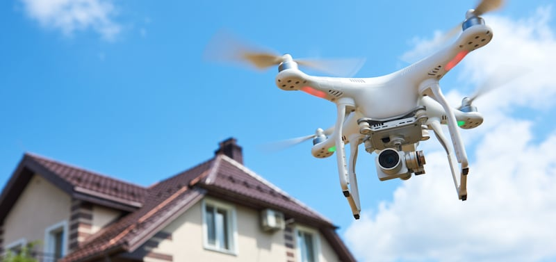 drone flying in residential area