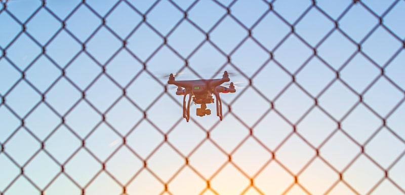 drone flying near fence