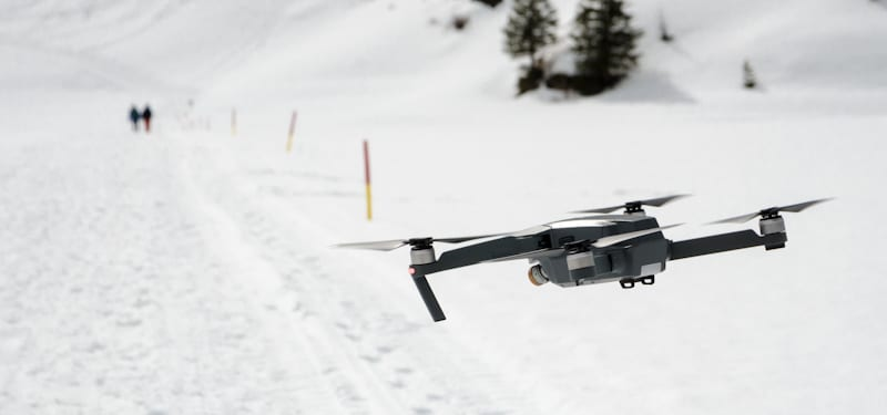 drone flying over the snow