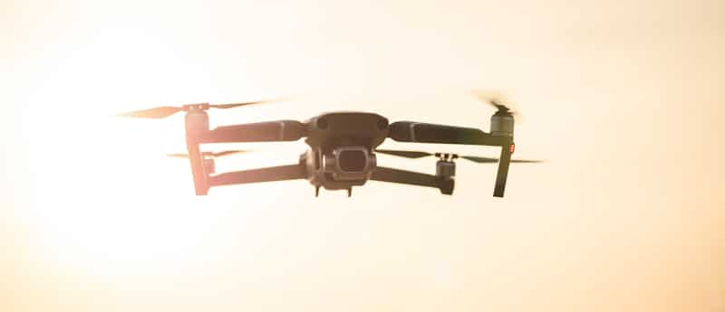 drone hovering in dessert dust