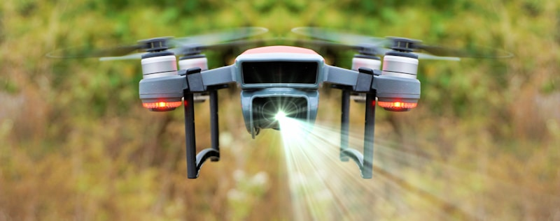 drone hovers and projects laser light from camera