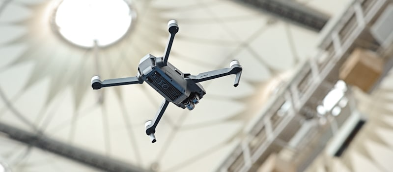 drone hovers in a indoors stadium
