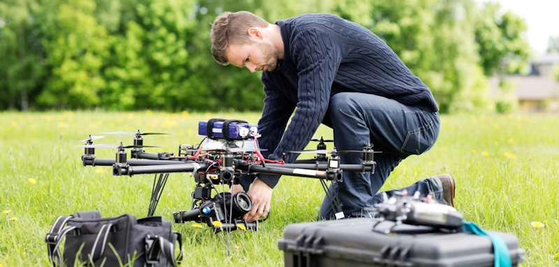 drone pilot prepares octocopter for flight