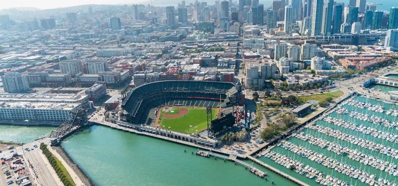 drone shot of baseball stadium by the sea