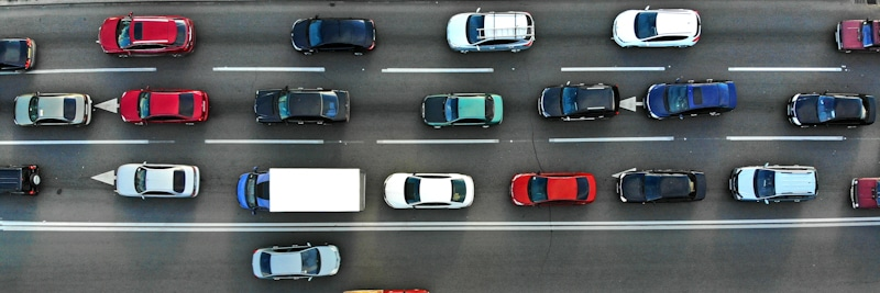 drone shot of moving traffic