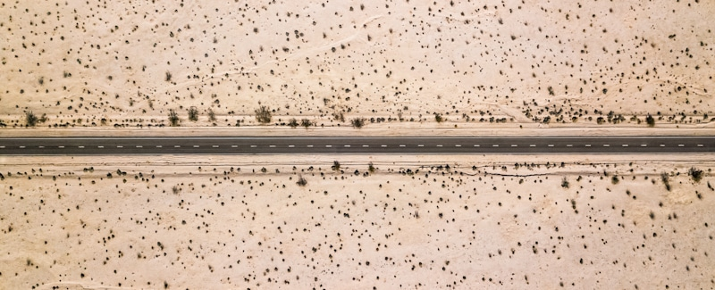 drone shot of road in the middle of death valley