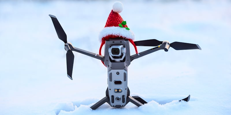 drone with christmas hat in the snow