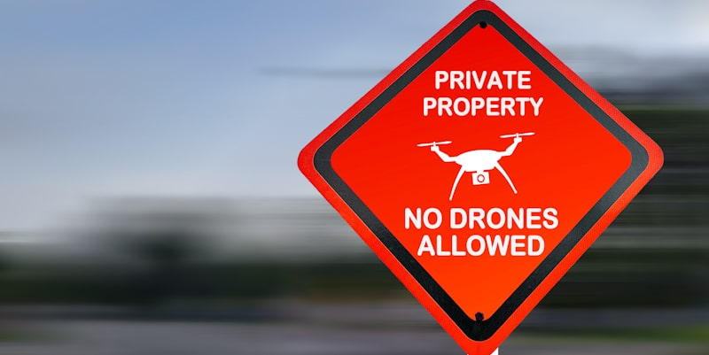 drones not allowed private property sign