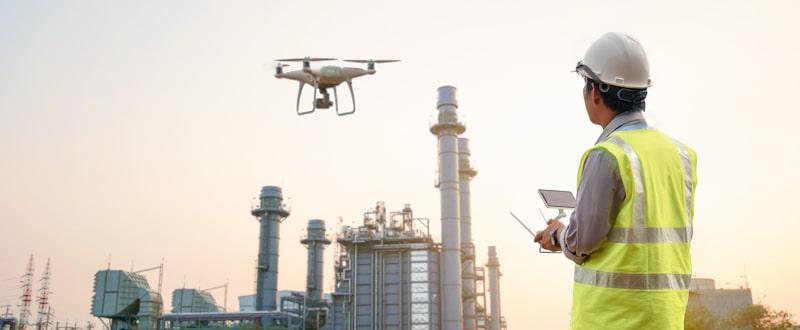 engineer flies drone near power plant