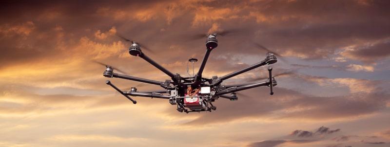 hexacopter drone flies in sunset