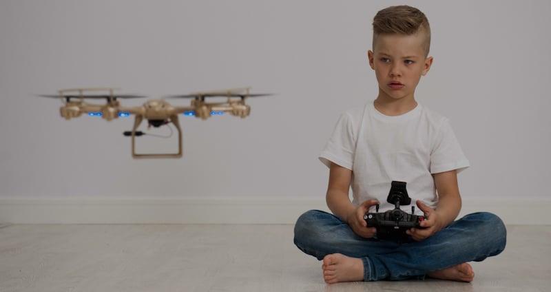 kid flying drone indoors