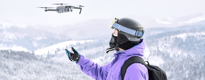 person flies drone in freezing temperature