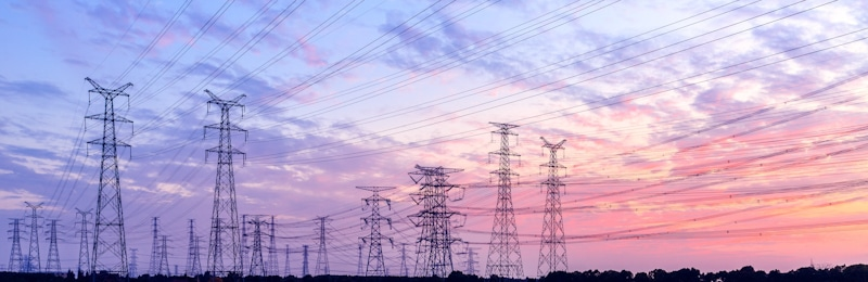 power lines and towers in sunrise