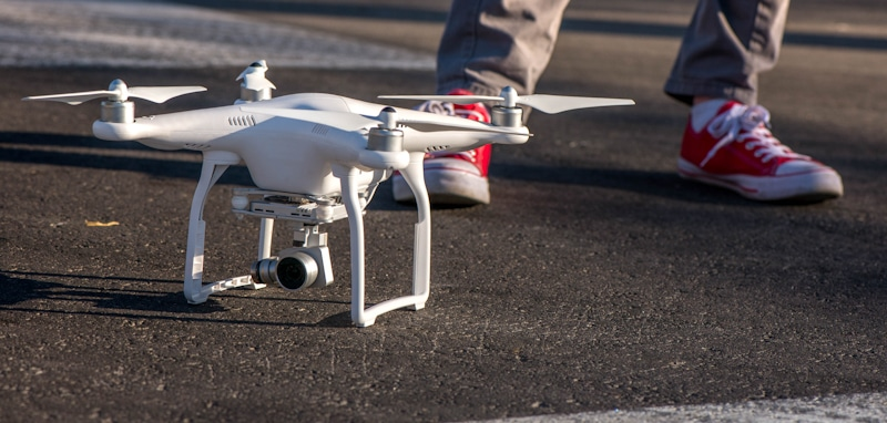 white drone placed on the street