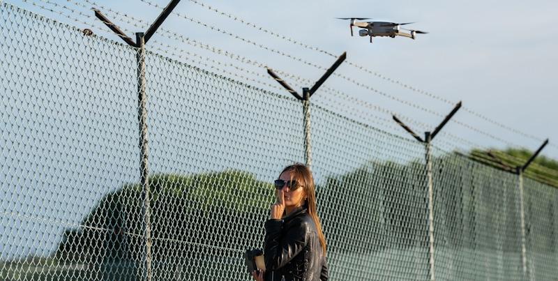 bad girl flies drone over fence