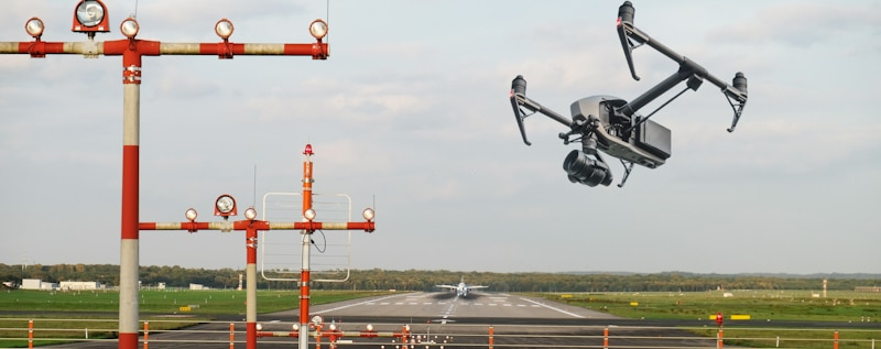 drone flies in the boundary fence of an airport