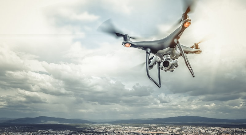 drone flies over city
