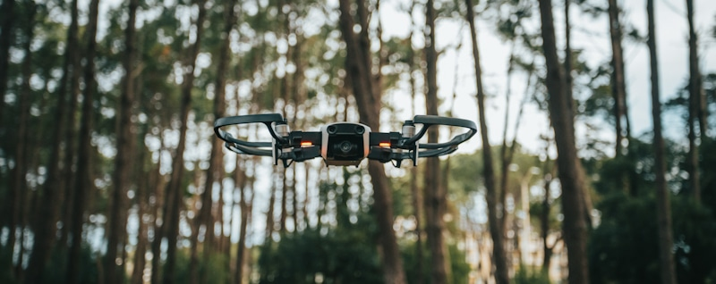 drone flying low in the woods