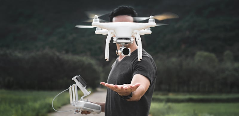 drone hovers above mans hand