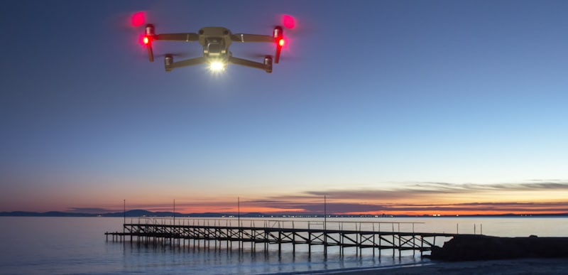 drone hovers on beach as takes pictures of sunset