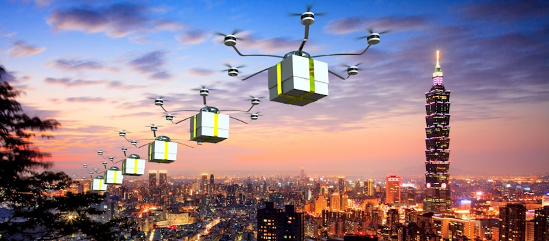future city and group of delivery drones fly together