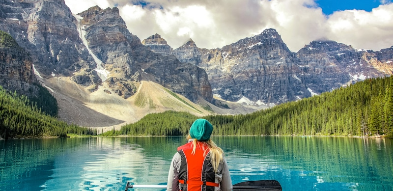 girl on canue looks at bear mountain national park