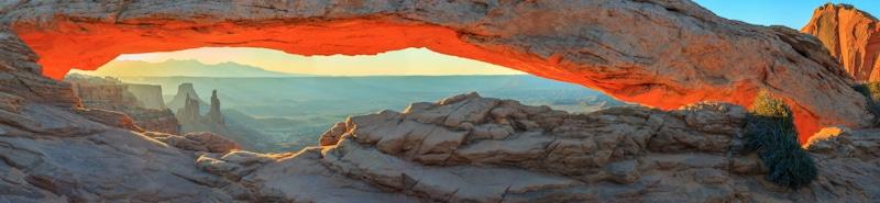 grand canyon bridge like rock formation at sunset