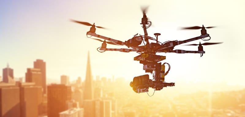 hexacopter drone hovers over city