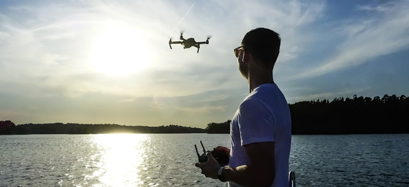 man flies drone from boat in line of sight