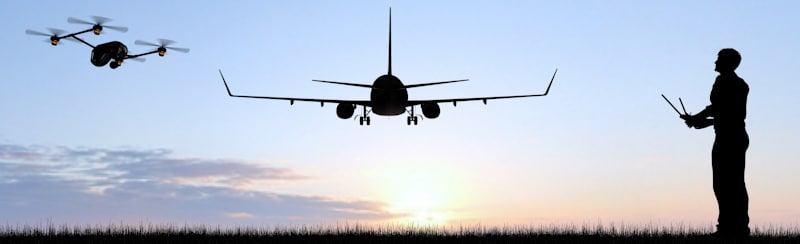 man flies drone in line of sight of landing plane