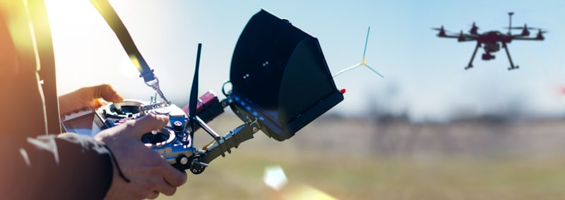 man with big controller flies hexacopter drone