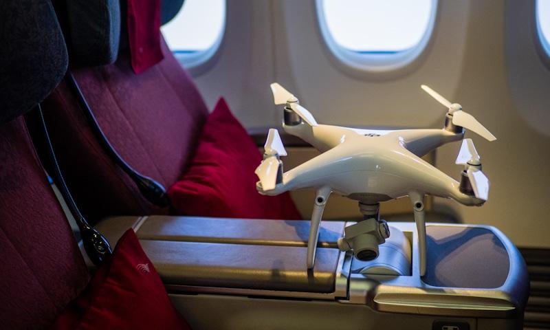 white dji drone in plane cabin