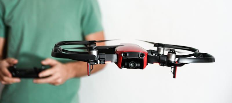 guy flies drone indoors