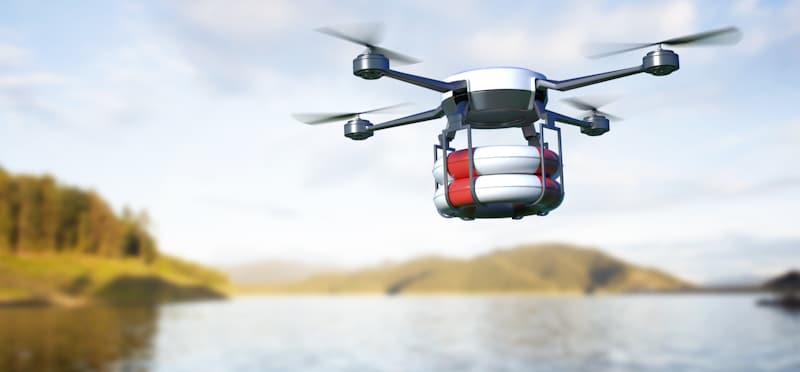 life guard drone flies over water carrying floats