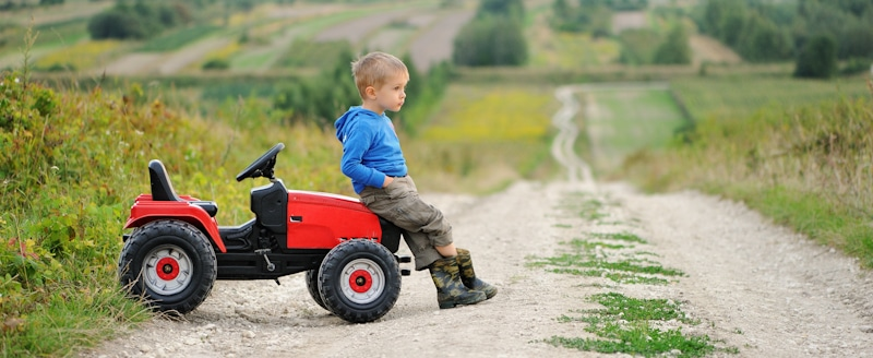 year old sits on toy atv
