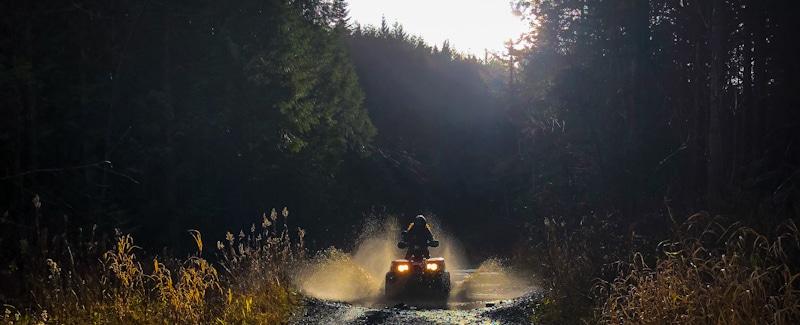 UTV rider speeds into muddy puddle