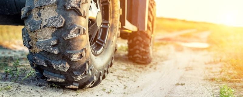 atv tires close up in sandy path