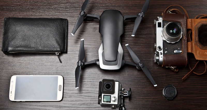 desk spread of drone with gopro camera